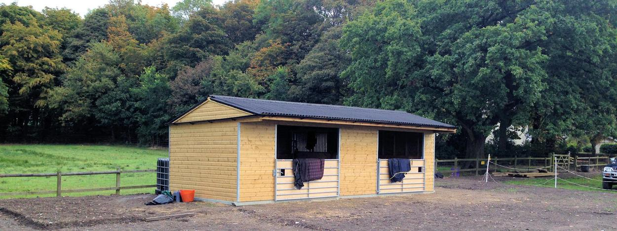 equestrian stables, shelters, accessories, buildings, arena surfaces company in Lancashire